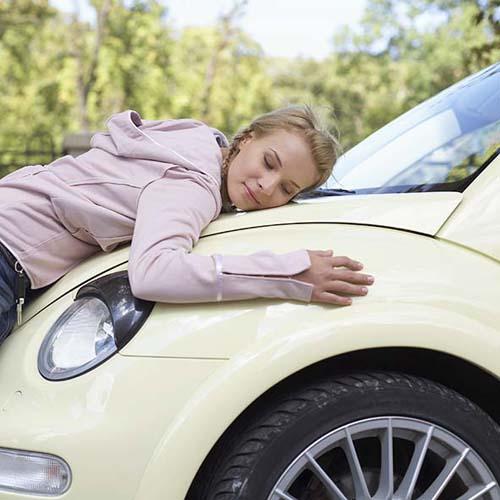 woman-hugging-car